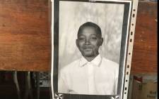 A picture of Adrian Alexander, who was killed in the mass shooting, is seen at his desk at the Holy Trinity Roman Catholic Primary School in Elsies River. Picture: Lauren Isaacs/EWN