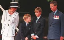 FILE: Princess Diana, her sons Harry and William, and Prince Charles watch the parade march past as part of the commemorations of VJ Day on 19 August 1995 in London. Picture: AFP