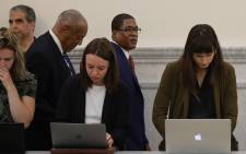 Actor and comedian Bill Cosby and his spokesman Andrew Wyatt pass reporters during a break at the Montgomery County Courthouse, during his sexual assault trial sentencing 24 September 2018 in Norristown, Pennsylvania. Picture: AFP