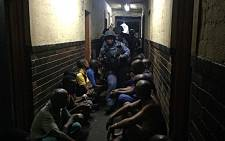 Police made several arrests during an overnight raid at a Jeppestown hostel in Johannesburg. Picture: Alex Eliseev/EWN
