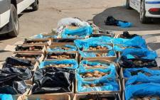 The Hawks in the Northern Cape together with the Department of Agriculture Forestry and Fisheries arrested two foreign nationals, aged 38 and 52, on Tuesday, 25 February 2020 for being in possession of abalone valued at R7 million. Picture: @SAPoliceService/Twitter