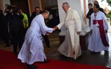 Pope Francis (C) is welcomed as he arrives at Palo Cathedral in Palo, Leyte, on January 17, 2015. Picture: AFP