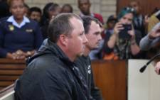 FILE: Willem Oosthuizen and Theo Jackson appear in the Middelburg Magistrates Court for assault and forcing another man to lie in a coffin. Picture: Christa Eybers/EWN.