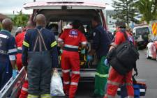 FILE: Paramedics attend to a patient in Grassy Park, Cape Town. Pciture: Nizaar Marlie.