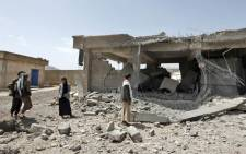 Yemenis check the damage in a power station in the aftermath of a reported air strike by the Saudi-led coalition in the Yemeni capital Sanaa on 20 April 2018. Picture: AFP