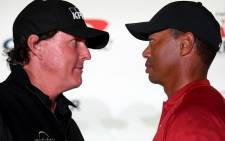 (L-R) Phil Mickelson and Tiger Woods face-off during a press conference before the match at Shadow Creek Golf Course on 20 November 2018 in Las Vegas, Nevada. Picture: AFP