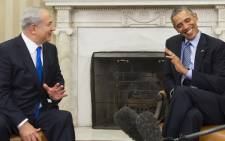 US President Barack Obama(R) and Israeli Prime Minister Benjamin Netanyahu hold a meeting in the Oval Office of the White House in Washington, DC, November 9, 2015. Netanyahu meets Obama in a bid to set aside their frosty personal ties, turn the page on the Iran nuclear deal and talk defense in the first encounter by the two leaders since October 2014. Picture: AFP.