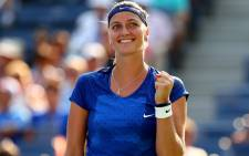 Petra Kvitova of the Czech Republic reacts after defeating Kristina Mladenovic of France to win their women's singles first round match on Day Two of the 2014 US Open. Picture: AFP.