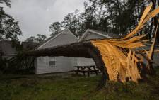 This US Navy photo obtained September 16, 2018 shows a tree collapsed on the Paradise Point houses during Hurricane Florence on Marine Corps Base Camp Lejeune, North Carolina on September 15, 2018. Picture: AFP