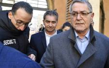 French Jean Fauret (R) and Bruno Odos (C), respectively pilot and co-pilot, arrive on 18 February 2019 at the Assize Court of Aix-En-Provence, southern France ahead of a court hearing in the trial over 'Air Cocaine' plot to smuggle planeload of drugs. Picture: AFP