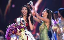 Catriona Gray of the Philippines reacts as she is crowned the new Miss Universe 2018 by Miss Universe 2017 Demi-Leigh Nel-Peters on 17 December, 2018 in Bangkok. Picture: AFP.