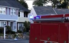 A screengrab shows a fire truck outside a home where explosions rocked a communities near Boston.