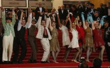 Dancers perform on the red carpet ahead of the opening of the 66th edition of the Cannes Film Festival in France on 15 May 2013. Picture: AFP