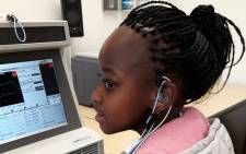Lime Mbali tests her new hearing aid at the Ear Institute. Picture: Ear Institute