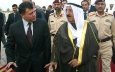 FILE: King Abdullah of Jordan (L) walks with King Sabah of Kuwait. Picture: AFP