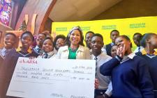 Dr Precious Motsepe poses with learners from a school in Soweto where the Motsepe Foundation donated money. Picture: Twitter/@EducationGP