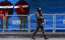 FILE: A Turkish special force police officer patrols in front of the Reina nightclub on 4 January 2017 in Istanbul, three days after a gunman killed 39 people on New Year's night. Picture: AFP.