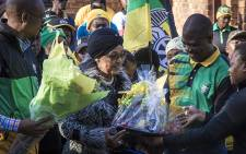 """""""Winnie Madikizela-Mandela is flanked by Joburg Mayor Parks Tau (L) and ANC Gauteng Chair Paul Mashatile (R) at her home in Soweto. Picture: Thomas Holder/EWN"""