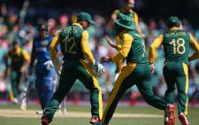 The Proteas celebrate after taking a Sri Lankan wicket during the quarterfinal of the Cricket World Cup at the SCG on 18 March 2015. Picture: AFP