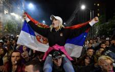 A protester waves the Serbian flag during a protest in front of the government building in Belgrade on 5 April 2017. Picture: AFP.