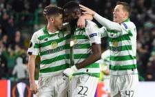 FILE: Celtic's Ryan Christie (L) Odsonne Edouard (C) and Callum McGregor celebrate a goal. Picture: AFP