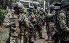 Kenyan special forces take position outside a hotel complex following an explosion in Nairobi's Westlands suburb on 15 January 2019, in Kenya. Picture: AFP