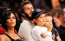 David and Vistoria Beckham with two of their sons. Picture: AFP