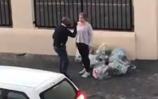 Screengrab of video showing police altercation with mask-wearing woman in Strand on Friday, 22 May 2020 during the COVID-19 lockdown. A probe into the conduct of the two officers involved in the incident is underway. Picture: Twitter video|@MurrayRSA