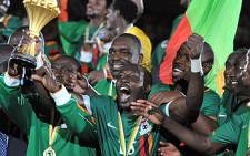 The Zambian football team celebrate after winning the African Cup of Nations in Libreville on 12 February 2012. Picture: AFP