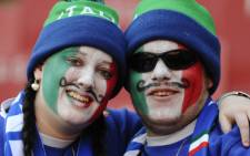 Italy soccer fans with the country's flag painted on their faces at Euro 2012 match with Croatia. Picture: AFP