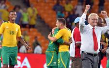 South Africa's coach Gordon Igesund celebrates his team's victory against Spain after a friendly football match at the Soccer City Stadium in Soweto on 19 November, 2013. Picture:AFP