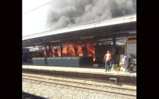 Two Metrorail trains set on fire at the Germiston station. Picture: Bonga Dlulane/EWN