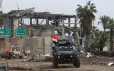 FILE: Iraqi forces, consisting of the Iraqi federal police and the elite Rapid Response Division, advance in the old city in western Mosul on 17 March 2017 during the ongoing offensive to retake the city from Islamic State group fighters. Picture: AFP.