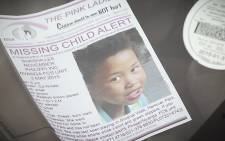 A missing person's flyer sits on a car dashboard in a resident's car in Hanover Park. Picture: Thomas Holder/EWN