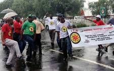 NTM members protest in the rain outside OR Tambo International Airport on 18 January 2013. Picture: Govan Whittles/EWN