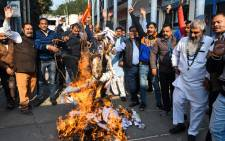 Activists from Shiv Sena Taksali shout slogans as they burn effigies of 'rapists' to protest against the alleged rape and murder of a 27-year-old veterinary doctor in Hyderabad, during a demonstration in Amritsar on December 5, 2019. Picture: AFP.