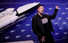 SpaceX owner and Tesla CEO Elon Musk gestures as he arrives on the red carpet for the Axel Springer Awards ceremony, in Berlin, on 1 December 2020. Picture: HANNIBAL HANSCHKE/POOL/AFP