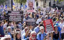 Demonstrators hold up placards in the sunshine at a protest against the move to suspend parliament in the final weeks before Brexit outside Downing Street in London on 31 August 2019. Picture: AFP.
