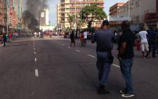 A standoff erupted between foreign owners and locals in Durban on 14 April 2015. Picture: Vumani Mkhize/EWN.