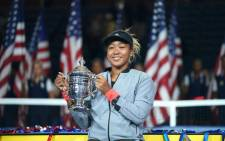 FILE: Naomi Osaka holding her trophy after winning the women's singles finals tennis match at the 2018 US Open. Picture: @usopen/Twitter