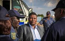 FILE: Minister of State Security David Mahlobo chats to police during a visit to Soshanguve. Picture: Thomas Holder/EWN