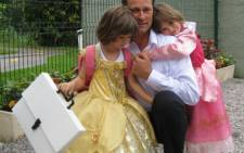 Erich Heine, who was on board the crashed Air France flight, pictured with two of his children. Picture Neil Long
