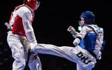 Brazil's Nathan Cesar Sodario Torquato (R) competes with Refugee Paralympic Team's Parfait Hakizimana in their men's taekwondo K44 -61kg bout during the Tokyo 2020 Paralympic Games at Makuhari Messe Hall in Chiba on 2 September 2021. Picture: Philip FONG/AFP