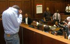 FILE: Zola Tongo covers his head as he prepares to face murder charges in the Cape High Court. Picture: EWN.