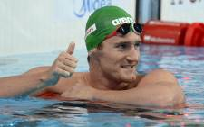 South Africa's Cameron Van der Burgh celebrates after competing in the semi-finals of the men's 50m breaststroke swimming event at the 2015 Fina World Championships in Kazan on 4 August 2015. Picture: AFP.