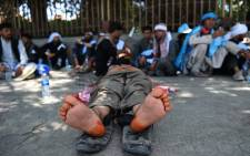 Afghan peace activists rest during a march, to demand an end to the war, from Helmand as they arrive in Kabul on 18 June 2018. Picture: AFP