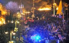 FILE: Anti-government protesters clash with the police during their storming of Independence Square in Kiev on 18 February. Picture: AFP.