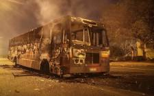At least two buses were torched during overnight protests in Mabopane north of Pretoria on 21 June 2016. Picture: Reinart Toerien/EWN.