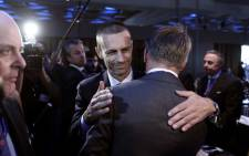 Uefa's newly elected president, Slovenian Aleksander Ceferin (C) is congratulated by Uefa representatives during the 12th Extraordinary Uefa congress in Lagonissi on 14 September 2016. Picture: AFP.