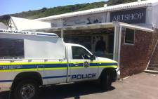 A police van outside the Isis Jewellery store in Hout Bay following an armed robbery on 24 October, 2014. Picture: Siyabonga Sesant/EWN.